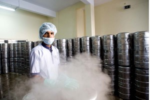 a worker mans the steam sterilizer for food vessels.