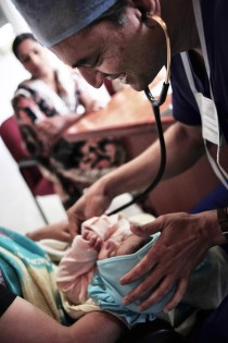 dr shetty examines a baby who has a heart defect